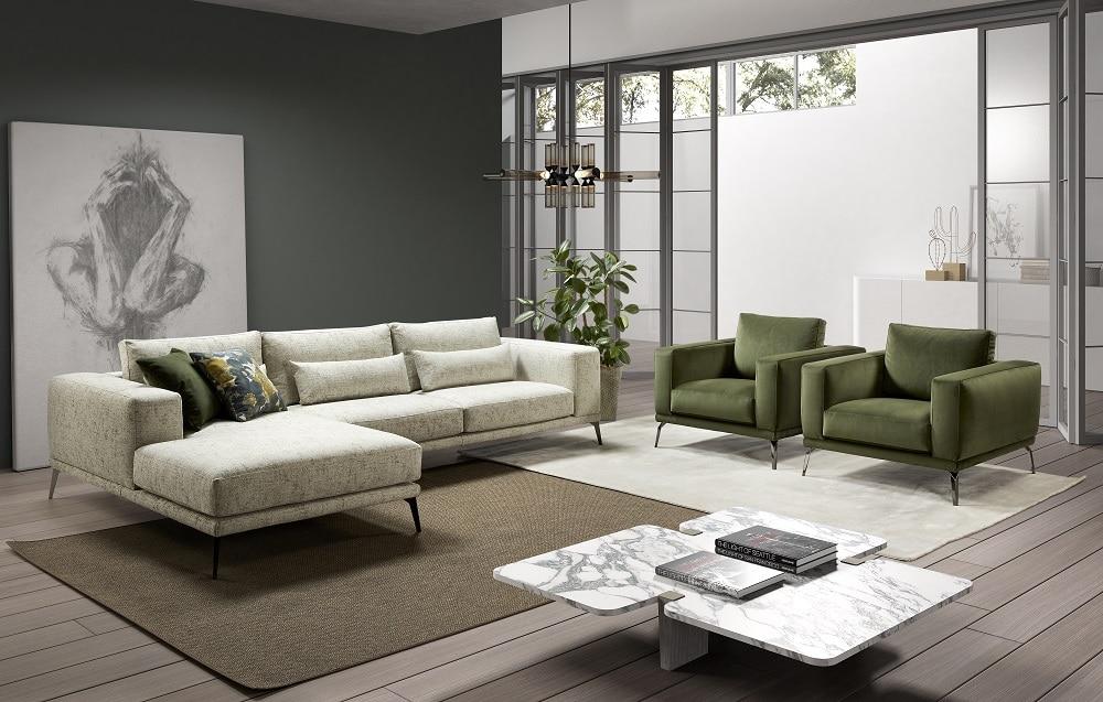 Sofá largo con tapicería clásica en blanco